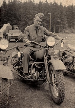 Lee MacDonald on bike at Ft. Lewis, 1941