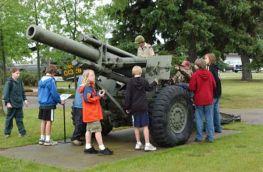 A Scout group checks out a 155mm M114 howitzer.
