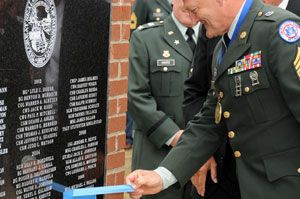 An honoree removes the tape from the monument marking his name in the Court of Honor, 2009.