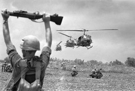 An American soldier uses an M79 Grenade Launcher to guide helicopters into an operation in South Vietnam's Mekong Delta, July 1968. (Henri Huet/AP)