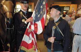 A reenactor eyes his stone-faced counterpart in the special exhibit Minnesota's Two Civil Wars.