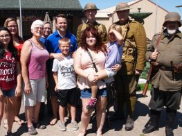 Visitors pose with World War I re-enactors during opening day of a new special exhibit