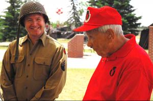 A WWII re-enactor meets a WWII Vet at the opening event for a new exhibit.