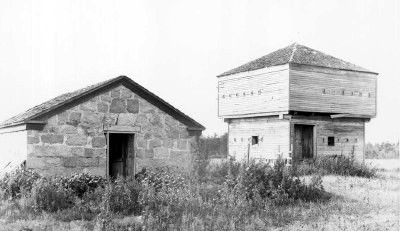 Powder magazine and northwest blockhouse about 1895.