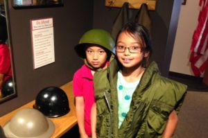 Kids enjoy a special corner of the museum where they can try on various uniforms and equipment.
